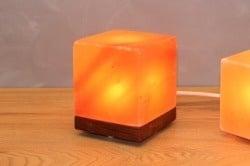 Cube Himalayan salt lamp on wooden base